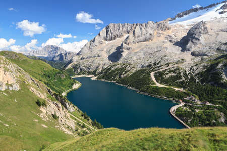 mount Marmolada and Fedaia lake, Trentino, Italy photo