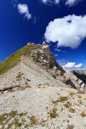 sud tirol: white clouds over mountain summit in Italian Dolomites