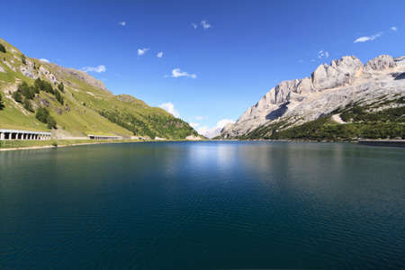 summer view of Fedaia lake and pass, Trentino, Italy photo