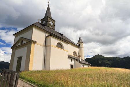 characteristic: characteristic alpine church in Laste, Veneto Italy