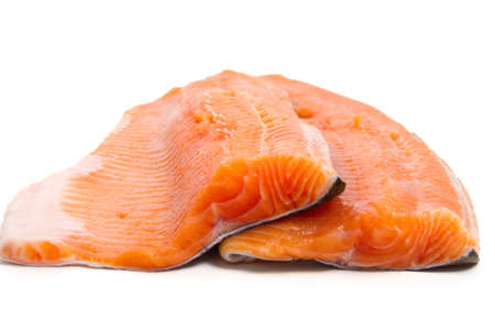 pink salmon: detail of salmon trout fillets over white background Stock Photo