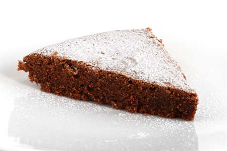 slice of chocolate cake over white background photo