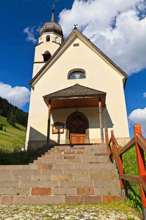 fassa: small church in Penia village, Fassa Valley, Trentino, Italy Stock Photo
