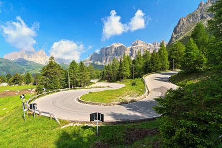 Dolomiti  winding road from Canazei to Pordoi pass photo