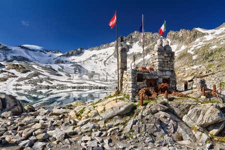 ww1: ww1 memorial in Lago del Monticello with Presena glacier on background, Italy