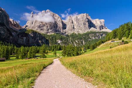 sella: footpath in high Badia Valley, on background Sella mount, Alto Adige, Italy Stock Photo