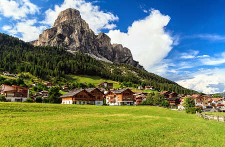 mount: overview of Corvara in Badia town and Sassongher,mount on summer, south Tyrol, Italy Stock Photo