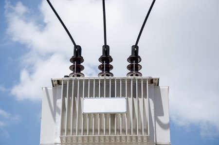 Transformer set on high with blue sky background. Фото со стока - 78101160