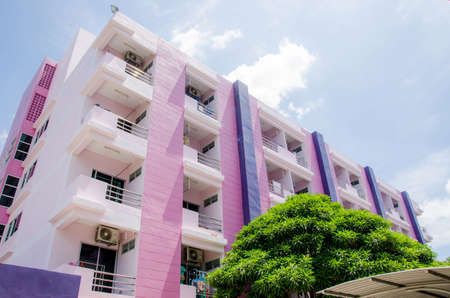 Purple dormitory building with blue sky background. Stock Photo