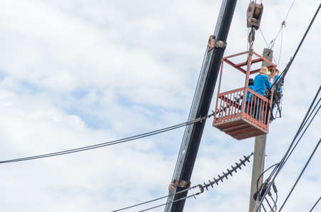 surge: Technicians are repairing high voltage transmission systems on the power poles.
