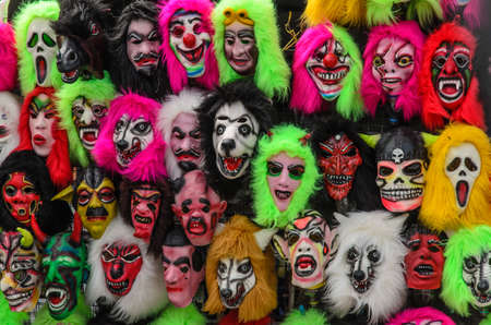 guise: Mask of fear  hang and arrange in rows to attract the attention of the audience. Stock Photo