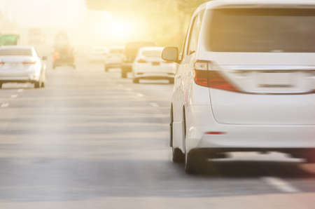 rear view of the white car is running on the road with sunset background,motion image,blurry photos 版權商用圖片