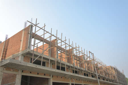 Residential buildings are being built on the blue sky.