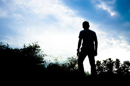 silhouette of a man looking to the front in a beautiful sky background