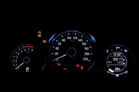 Car digital dashboard display warning lamps illuminated show all signs during system check on engine start. Archivio Fotografico