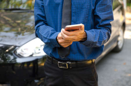 man holding smartphone hands and touching screen of modern mobile phone. Stok Fotoğraf