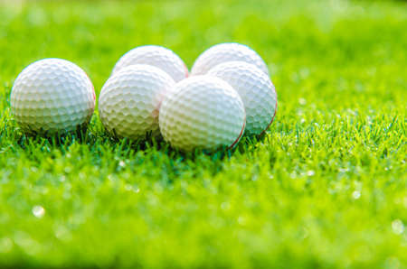golf ball on green grass with copy space Standard-Bild
