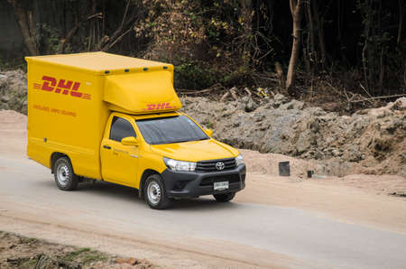 Samut Sakhon Thailand - August 2019 : DHL's small truck runs in the countryside, outside town on August 3, 2019 at Samut Sakhon, Thailand.