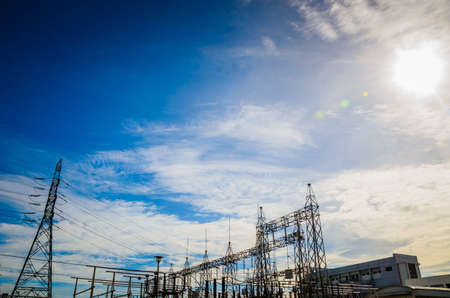 Substation with sunlight on blue sky background