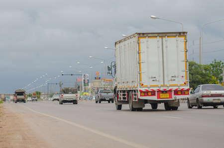Samut Sakhon, Thailand - August 2019: White trucks ran for transportation on Rama 2 Road on August 12, 2019 in Samut Sakhon Province, Thailand.