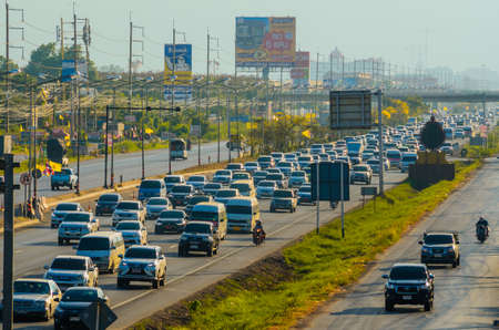 Samut Sakhon Thailand - April 2019 : Cars stands in traffic jam at afternoon at Rama II road on April 16, 2019 in Samut Sakhon, Thailand.