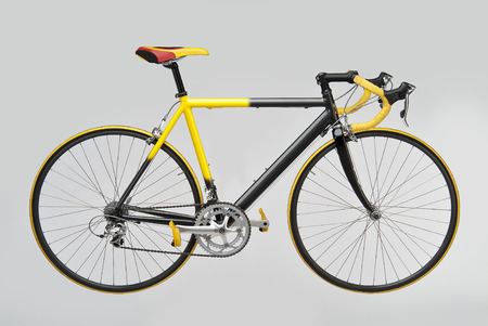 Yellow Black Bicycle Racing on white background 写真素材