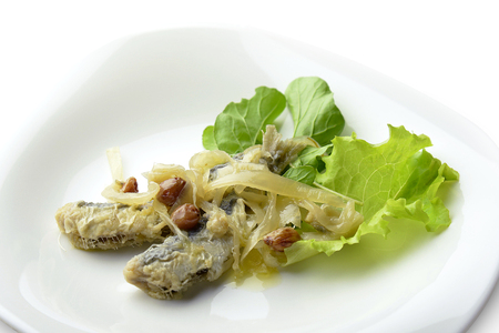 Appetizer of Fish Marinated Anchovies in white plate