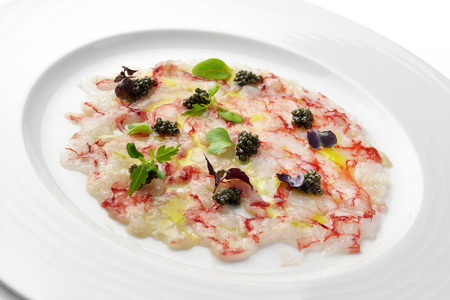Fish Appetizer Carpaccio of Red Prawns and Caviar in white round plate