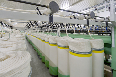 spinning factory: Deep perspective of textile spinning machine in factory Stock Photo