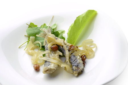 seafish: Appetizer of Fish Marinated Anchovies in white plate