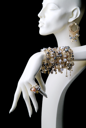 White Mannequin with Jewelry Rings Bracelets Necklaces and Earrings