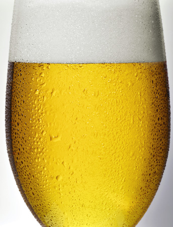 cold beverages: Detail, glass of beer with drops condensation Stock Photo