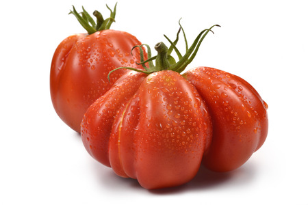 beefsteaks: Two Big Beefsteak Tomatoes with Drops on white board