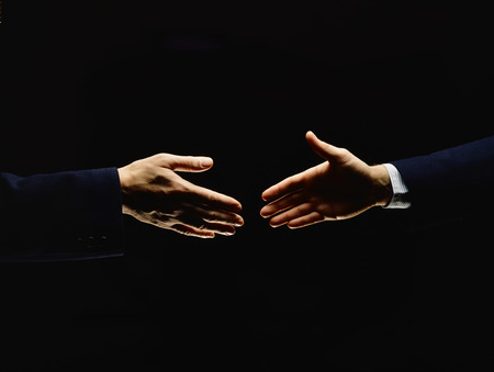 handclasp: Two men Handshake Moving in black background
