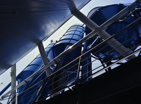 Bottom perspective of storage Tower Silos blue 写真素材