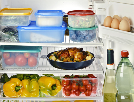 Open Refrigerator with Assortment of Food and Beverages