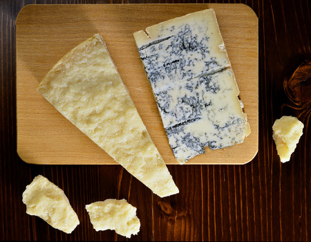 Parmesan: Cutting Board with Parmesan and Gorgonzola Cheese Stock Photo