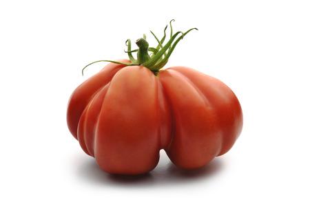 beefsteaks: One Big Beefsteak Tomato on white board Stock Photo