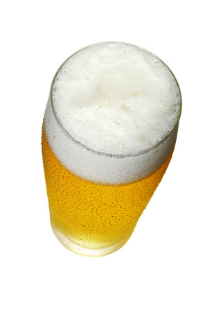 Glass of Beer with foam and drops top View