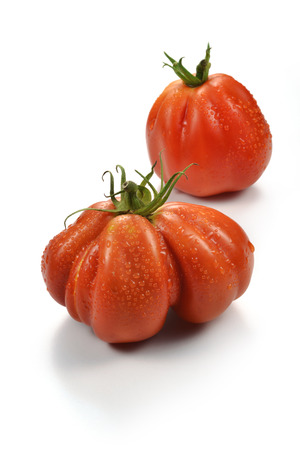 beefsteak: Two Big Beefsteak Tomatoes with Drops on white board