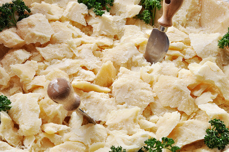 shavings: Appetizer of Parmesan cheese shavings with knives
