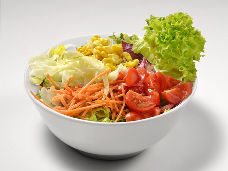 Bowl of Mixed Salad with tomato lettuce carrot corn Stock Photo