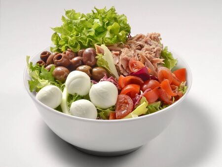 Salad with Lettuce Olives Mozzarella and Tuna in bowl