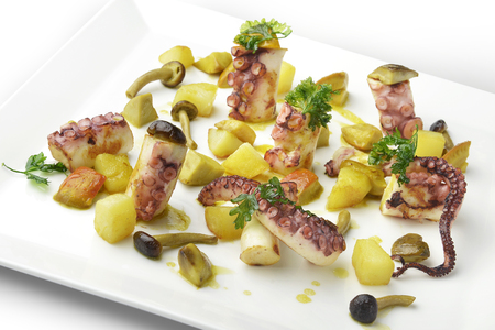 braised mushrooms: Appetizer Braised octopus with potatoes and mix of mushrooms