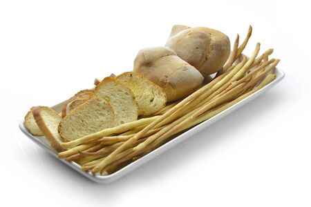 gressins: Tray of Bread and breadsticks and slices toasted bread Banque d'images
