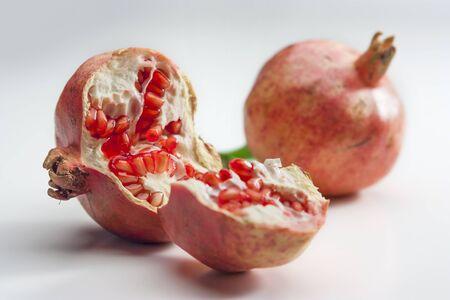 pomegranate: Brocken Pomegranate Fruit isolated on white plane Stock Photo