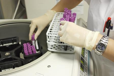 centrifuge: Rack with test tubes of blood and Centrifuge Stock Photo
