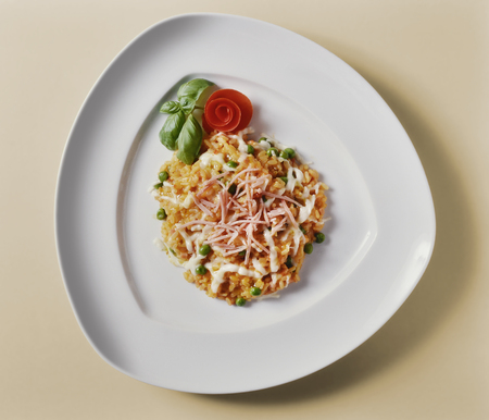 recipe decorated: Top view of Tomato Risotto with Peas and Ham