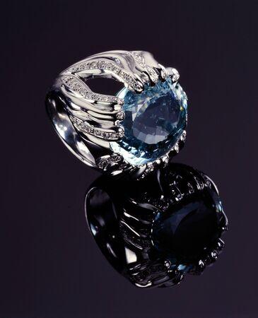 platinum: Platinum Ring with Blue Diamond on Black background