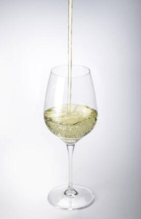 sauvignon blanc: Stem Glass of White Wine on white plane